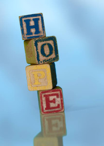 Stack of wooden building blocks spelling HOPE