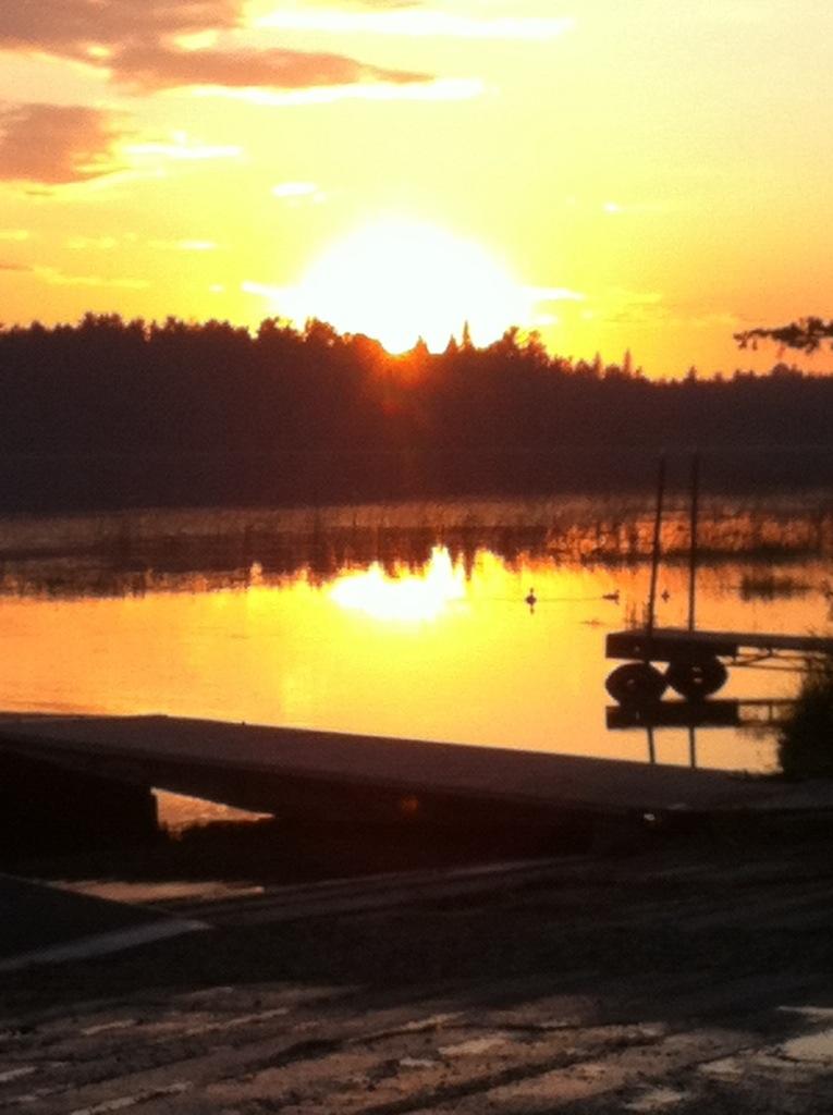 The sun sets behind a Minnesota lake