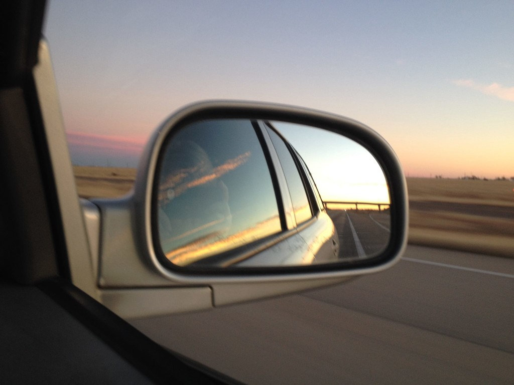 View of sunrise from sideview mirror